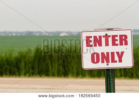 Summer humidity farm land and a sign