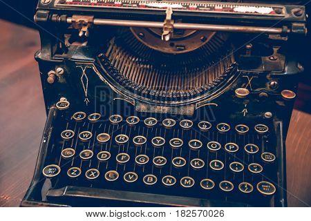 Keys of an old vintage typewriter beginning of the twentieth century, close-up, toned