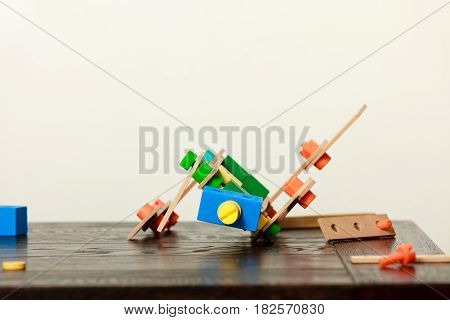 Childhood kids imagination diy toy ideas concept. Wooden colorful kid toys on table