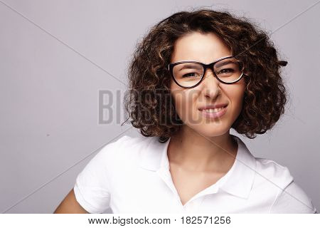 lifestyle, business  and people concept: business woman in glasses over white background