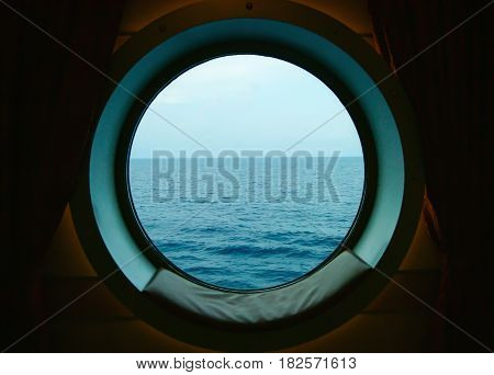 Porthole on ship with ocean view outside