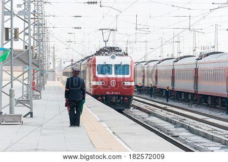 Gansu, China - Apr 09 2015: China Railways Ss7E Electric Locomotive In Wuwei Railway Station, Gansu,