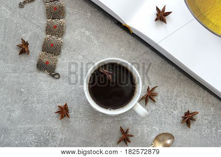 Coffe and book on the stone table
