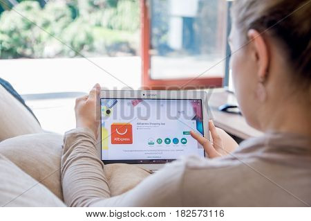 Wroclaw, Poland- April 10Th, 2017:  Woman Is Installing Aliexpress Application On Lenovo Tablet. Ali