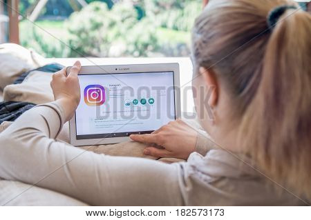 Wroclaw, Poland- April 10Th, 2017:  Woman Is Installing Instagram Application On Lenovo Tablet. Inst