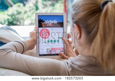 Wroclaw, Poland- April 10Th, 2017:  Woman Is Installing Airbnb Application On Lenovo Tablet. Airbnb