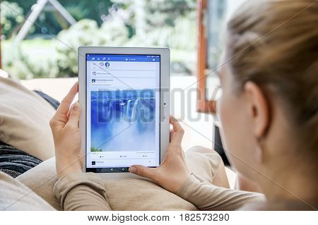 Wroclaw, Poland- April 10Th, 2017:  Woman Launches Facebook Application On Lenovo Tablet. Facebook I