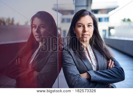 Portrait of a confident, happy female business executive wearing fashionable suit on her way to the next consultant meeting