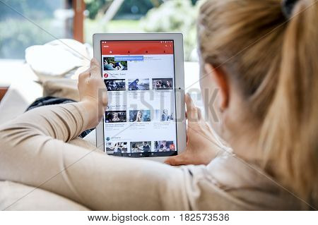 Wroclaw, Poland- April 10Th, 2017:  Woman Launches Youtube Application On Lenovo Tablet. Youtube Is