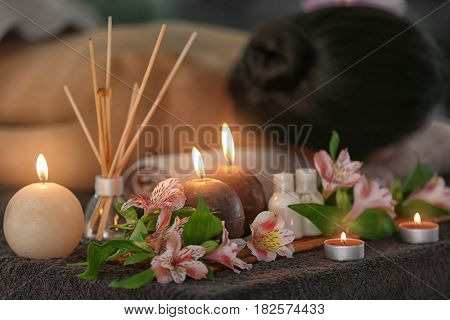 Beautiful spa composition with candles and flowers in modern wellness center