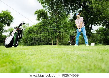 Golfer getting ready to hit the first long shot