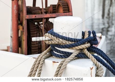 White Bow Bollard With Ropes Mounted On Old Ship
