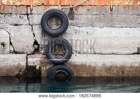 Concrete Mooring Wall With Old Used Tires