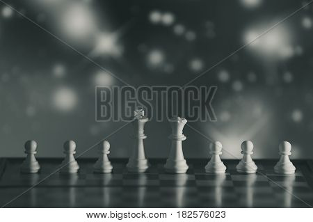 Chess background central figure. Chess strategy concept is on the bright background. Abstract background of business concept . Selective focus shallow depth field. Monochrome