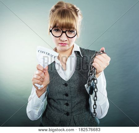 Businesswoman woman ending agreement deal. Young girl holding chain breaking free creasing squeezing paper. Termination breach of contract.