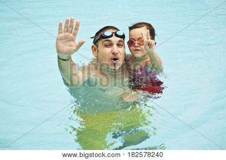 Father and Daughter In Swimming Pool, summer vacation
