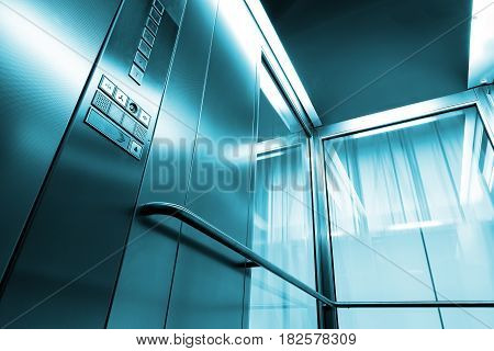 Inside metal and glass Elevator in modern building , the shiny button railings