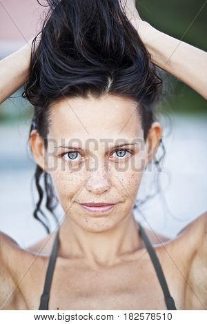 Portrait of sensual woman with freckles, clouse up