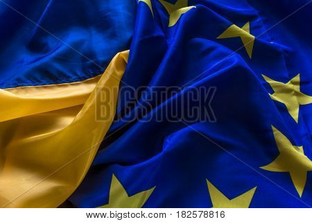 The flag of Ukraine and the flag of the European Union are woven together