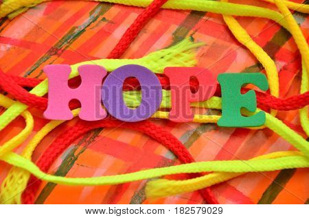 WORD HOPE ON A  ABSTRACT COLORFUL BACKGROUND