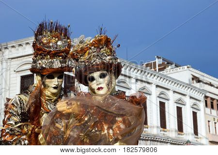 VENICE - FEB 6 2013: Costumed people on the Piazza San Marco during Venice Carnival