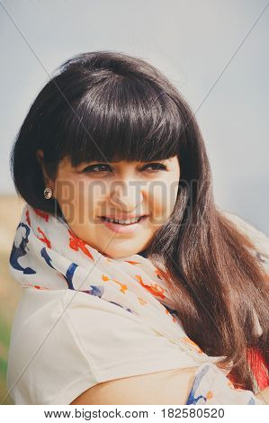 Happy Smiling Beautiful Overweight Young Woman In White T-shirt And Scarf With Anchor Outdoors. Conf