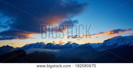 Snow capped mountains. Summits of the mountains. View of the Matterhorn region mountains at the sunrise. Trek near Matterhorn mount.