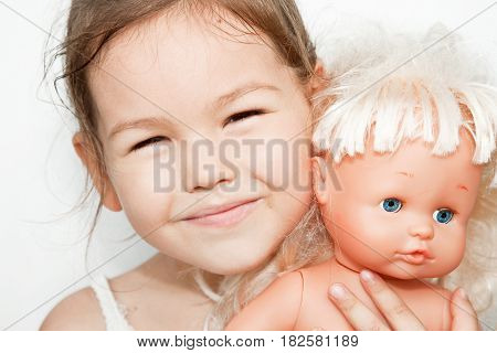Little cute girl with a doll, mix race
