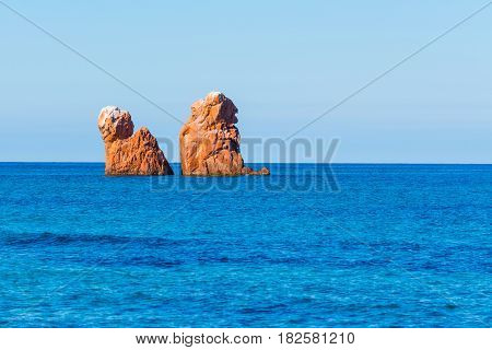 orange sea stacks in Cea Beach, Sardinia