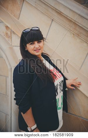 Happy Smiling Beautiful Overweight Young Woman In Dark Blue Jacket Outdoors At The Street. Confident