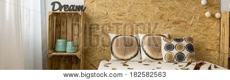 Bedhead, Pillows And Handmade Rack At The Wooden Wall