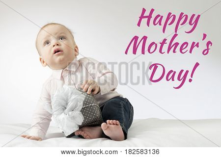 Adorable Baby Boy With A Gift. Postcard For Mothers Day. Cute Infant Boy Sitting With A Present