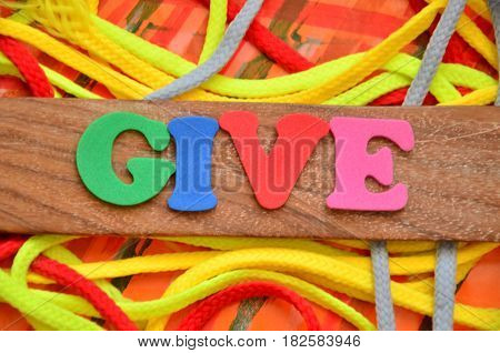 WORD GIVE ON An  ABSTRACT COLORFUL BACKGROUND