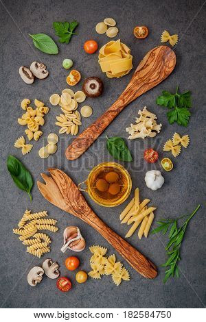 Italian Foods Concept And Menu Design. Fettuccine With Wooden Spatula And Ingredients Sweet Basil ,t