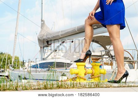Woman Standing One Leg On Marina Bitt