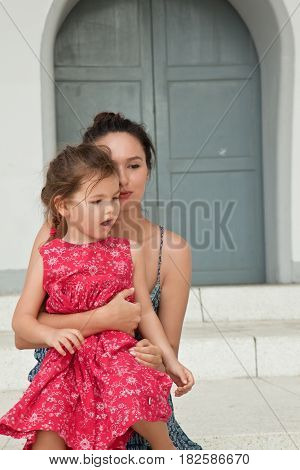 Portrait of a young family. Young woman talks with a child