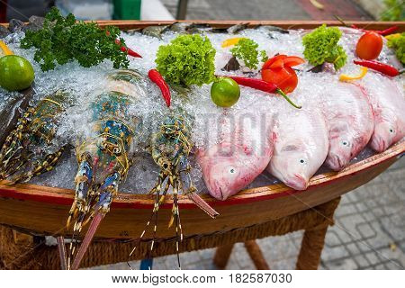 Seafood in a wooden boat on the street market