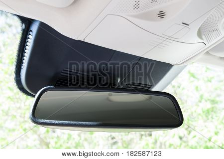 Closeup Of Rear View Mirror In Modern Car Interior