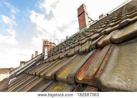 Old roof with roofing tiles and chimneys