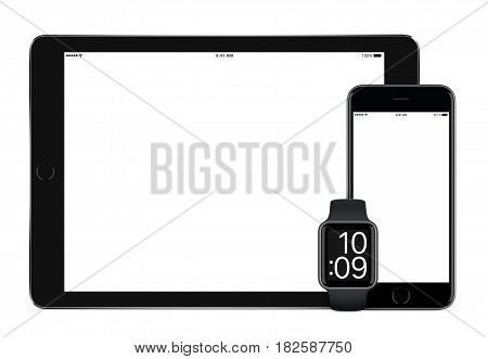 Responsive mockup consisting of black tablet pc, mobile smartphone and smart watch. All gadgets in focus. Isolated on white background. Technology set for responsive design presentation.