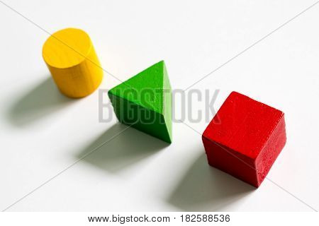 Set of colorful wooden shape toy (Square triangle round) on white background
