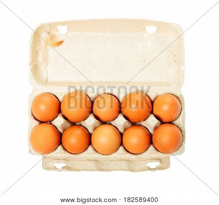 Cardboard egg box with ten eggs isolated on white background