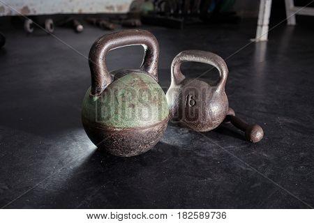Dumbbells in the old gym room. 16, 24 kg