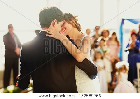 Sun Shines Over Happy Just Married Couple While They Dance At The First Time