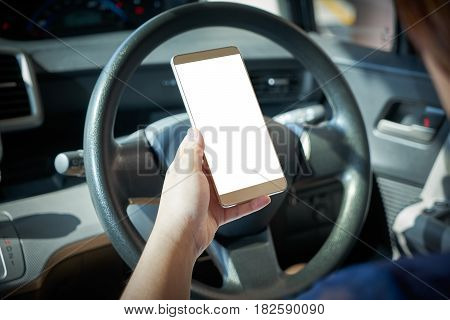 Woman driver using smart phone in car during traffic jam blank white screen for design purpose .