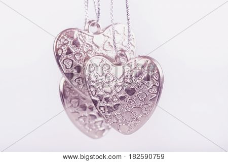 Three pink Hearts on white background selective focused Valentine. love heart beauty