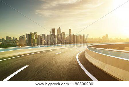 Highway overpass modern city skyline background . Evening scene .