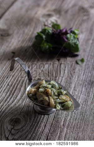 Homemade mushroom sauce on a wooden background