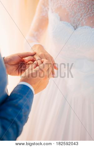 The newlyweds exchange rings at a wedding in Montenegro.