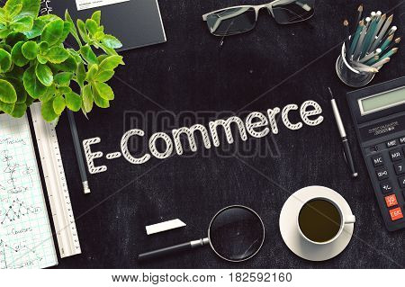 E-Commerce on Black Chalkboard. 3d Rendering. Toned Image.